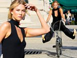 New York, NY - Karlie Kloss proves that she's a versatile model. The 23 year old looks like she is having a blast while on set of a photoshoot in the Big Apple. The blonde hops on a bike and does a few nifty tricks for the cameras, all in a pair of heels! She is wearing a cutout choker top and trousers as she strikes a pose on location.\nAKM-GSI          July 6, 2016\nTo License These Photos, Please Contact :\nMaria Buda\n(917) 242-1505\nmbuda@akmgsi.com\nsales@akmgsi.com\nor \nMark Satter\n(317) 691-9592\nmsatter@akmgsi.com\nsales@akmgsi.com\nwww.akmgsi.com