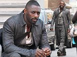 154619, Idris Elba seen in full costume as gunslinger Roland while filming The Dark Tower. Idris can be seen running through the busy and crowded streets of Chinatown after purchasing weapons from a gun shop in Downtown Manhattan. Kid costar Tom Taylor is also pictured sitting alongside Idris. New York, New York - Thursday July 7, 2016. Photograph: © LGjr-RG, PacificCoastNews. Los Angeles Office (PCN): +1 310.822.0419 UK Office (Photoshot): +44 (0) 20 7421 6000 sales@pacificcoastnews.com FEE MUST BE AGREED PRIOR TO USAGE