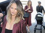Los Angeles, CA - Chrissy Teigen arrives for a Friday flight out of Los Angeles at LAX with her daughter Luna and John Legend close behind. The model wore another cleavage baring top under a silk robe as she pushed her daughter in her stroller through the terminal for their flight.\nAKM-GSI   July  8, 2016\nTo License These Photos, Please Contact :\nMaria Buda\n(917) 242-1505\nmbuda@akmgsi.com\nsales@akmgsi.com\nor \nMark Satter\n(317) 691-9592\nmsatter@akmgsi.com\nsales@akmgsi.com\nwww.akmgsi.com