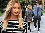 Los Angeles, CA - Ashley Tisdale steps out looking sexy in stripes with beau Christopher French. Ashley looks like she's trying out the new Lampshading trend in a long sleeved short striped dress and thigh high black boots which she accessorized with a black Givenchy Crossover bag.\n  \nAKM-GSI       July 8, 2016\nTo License These Photos, Please Contact :\nMaria Buda\n(917) 242-1505\nmbuda@akmgsi.com\nsales@akmgsi.com\nMark Satter\n(317) 691-9592\nmsatter@akmgsi.com\nsales@akmgsi.com