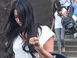 Ex-TOWIE star Cara Kilbey leaves H.M.P Wandsworth after visiting her partner Daniel Harris on July 07 2016. Mr Harris was charged with conspiracy to supply cocaine after officers seized GBP 300,000 cash and 10kgs of cocaine in a raid. He is due to stand trial with eight others at the Old Bailey. See National story NNTOWIE; Ex-TOWIE babe Cara Kilbey was spotted stumbling out of prison ? after a whopping three hour visit with her �bad boy? boyfriend. Essex girl Cara, 28, took her five-month-old baby Penelope Blu with her during the triple-length visit to see banged-up boyfriend Daniel Harris, currently on remand for drug offences. Cara, who gave birth to her first child this year after suffering a heart-wrenching miscarriage, looked far from her going out finest, wearing casual grey jeans and a low-cut white t-shirt as she visited the largest prison in Britain. She appeared to have had a stressful time inside, because the bronzed beauty pulled out a cigarette as she was walking down the