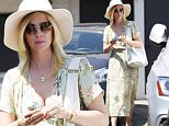 EXCLUSIVE: January Jones keeps cool under a fedora hat after spending the day getting pampered at meche salon in Los Angeles, California.\n\nPictured: January Jones \nRef: SPL1314582  070716   EXCLUSIVE\nPicture by: Splash News\n\nSplash News and Pictures\nLos Angeles: 310-821-2666\nNew York: 212-619-2666\nLondon: 870-934-2666\nphotodesk@splashnews.com\n