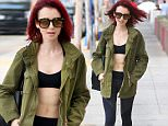 West Hollywood, CA - Lily Collins shows off her auburn locks and significantly toned abdominals while out running errands in West Hollywood. The 27-year old actress has been sporting a much smaller frame lately, but it's easy to see that it all has to do with a strict, consistent work out regimen. Lily is always a bit shy with our pap but never fails to thank him for his endless stream of compliments.\nAKM-GSI          July 8, 2016\nTo License These Photos, Please Contact :\nMaria Buda\n(917) 242-1505\nmbuda@akmgsi.com\nsales@akmgsi.com\nor \nMark Satter\n(317) 691-9592\nmsatter@akmgsi.com\nsales@akmgsi.com\nwww.akmgsi.com
