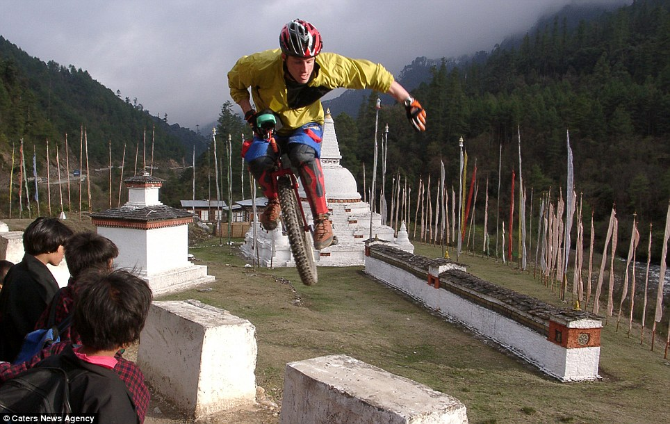Mountain king: Mr Holm in Bhutan he designs and sells his own mountain unicycles