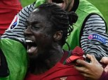 Portugal's forward Eder (C) celebrates after scoring a goal with team mates during the Euro 2016 final football match between Portugal and France at the Stade de France in Saint-Denis, north of Paris, on July 10, 2016. / AFP PHOTO / PHILIPPE LOPEZPHILIPPE LOPEZ/AFP/Getty Images