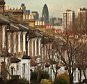 A row of houses lies in sight of Canary Wharf viewed from south London on January 22, 2009 in England. The number of repossession orders is up 92 per cent in the third quarter of 2008 compared to the same period in 2007.    LONDON, ENGLAND - JANUARY 22:   (Photo by Peter Macdiarmid/Getty Images)