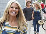 EXCLUSIVE TO INF.\nJuly 09, 2016:  Christie Brinkley shops with son Jack at the Anthony Thomas Melillo Hamptons Pop-up Shop shop in East Hampton, NY.  Store clerks help bring out the bags to her SUV as Christie greets protestors carrying 'Black Lives Matter' signs outside of the store.\nMandatory Credit:  Matt Agudo/INFphoto.com  Ref: infusny-251