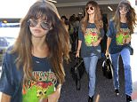 EXCLUSIVE: Selena Gomez seen in a new hairstyle with bangs and highlights while wearing a torn Guns n' Roses shirt, tight blue jeans, boots with yellow heels.  Selena Gomez was seen with her bodyguards flying out of LAX.  Pictured: Selena Gomez Ref: SPL1316367  100716   EXCLUSIVE Picture by: Sharky/Polite Paparazzi/Splash  Splash News and Pictures Los Angeles: 310-821-2666 New York: 212-619-2666 London: 870-934-2666 photodesk@splashnews.com