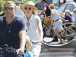 Brentwood, CA - Naomi Watts and husband Liev Schreiber take their two sons Samuel and Alexander on a bike ride at the Farmer's Market. Naomi is wearing a light denim button up dress and camel sandals paired with a hat and sunglasses. \nAKM-GSI          July 10, 2016\nTo License These Photos, Please Contact :\nMaria Buda\n(917) 242-1505\nmbuda@akmgsi.com\nsales@akmgsi.com\nor \nMark Satter\n(317) 691-9592\nmsatter@akmgsi.com\nsales@akmgsi.com\nwww.akmgsi.com