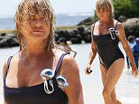 Exclusive... 52118305 70 year old actress Goldie Hawn shows off her amazing physique while enjoying a day on the beach in Hawaii on July 9, 2016. Goldie is down in Hawaii working on a new adventure comedy movie with comedian Amy Schumer. **NO USE W/O PRIOR AGREEMENT-CALL FOR PRICING** FameFlynet, Inc - Beverly Hills, CA, USA - +1 (310) 505-9876