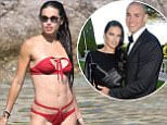 MYKONOS,GREECE 10TH JULY 2016: Brazilian supermodel Adriana Lima shows off her toned figure in a red bikini at the beach in Mykonos, Greece. Adriana was seen chatting with friends while swimming in the sea. July 10, 2016.   Photo Mavrix/SilverHub 0203 174 1069