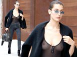11 July 2016.....American fashion model Bella Hadid hits the streets of New York City sporting an entirely see through top as part of a daring black array which also included a cardigan worn off the shoulder, high heels, black lace up jeans and hippie chic shades.....Credit: GoffPhotos.com   Ref: KGC-339/TIDNY-48..**UK Sales Only - No Daily Mail Online, No Sun Online**
