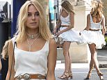 EXCLUSIVE: Actress Kimberley Garner looks angelic in white as she partakes in a spot of retail therapy with her mother on London's Kings Road.