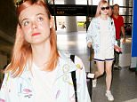 July 12, 2016: Elle Fanning sports pink hair and a tennis patterned jacket with white shorts and tee as she departs LAX Airport, Los Angeles, CA.\nMandatory Credit: INFphoto.com Ref.: inf-00