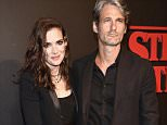 """LOS ANGELES, CA - JULY 11:  Actress Winona Ryder and Scott Mackinlay Hahn attend the Premiere of Netflix's """"Stranger Things"""" at Mack Sennett Studios on July 11, 2016 in Los Angeles, California.  (Photo by Alberto E. Rodriguez/Getty Images)"""