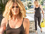 Agoura Hills, CA - Khloe Kardashian's waist line looks slimmer than ever as she filmed 'Keeping Up With The Kardashians' on location in Agoura Hills. She opted for no bra and it clearly showed. Kim dropped her off at her SUV after filming scenes for the show. The slimmed down reality star put on a brave face after the latest drama with her ex-Lamar Odom. AKM-GSI      July 12, 2016 To License These Photos, Please Contact : Maria Buda (917) 242-1505 mbuda@akmgsi.com sales@akmgsi.com or Mark Satter (317) 691-9592 msatter@akmgsi.com sales@akmgsi.com www.akmgsi.com