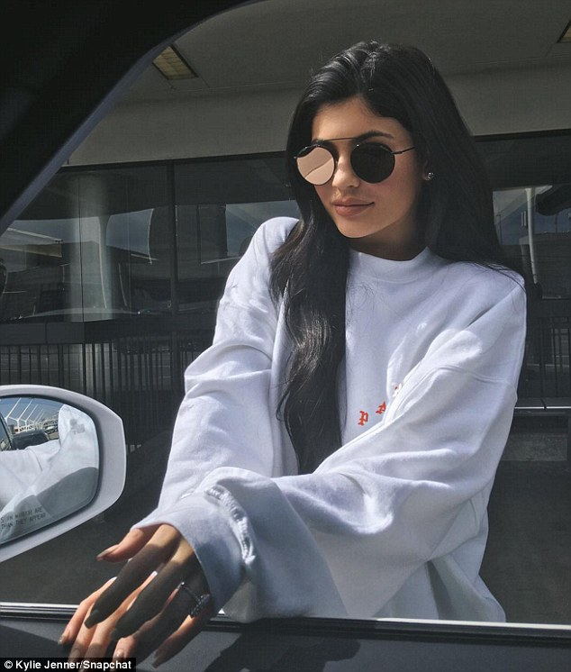 Ringing in rumours:Kylie first sparked engagement rumours when she shared an Instagram snap of herself sporting the ring while posing in front of her car on Friday