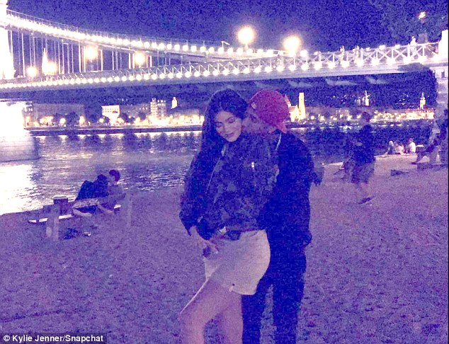 Snuggling up: On Monday evening, the star shared another amorous photo to Snapchat with her man