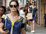 New York, NY - Katie Holmes is seen out and about in Soho after some shopping at A.P.C. The 37-year-old actress is wearing a navy blue dress, with yellow embroidery details, paired with white sneakers. \nAKM-GSI          July 12, 2016\nTo License These Photos, Please Contact :\nMaria Buda\n(917) 242-1505\nmbuda@akmgsi.com\nsales@akmgsi.com\nor \nMark Satter\n(317) 691-9592\nmsatter@akmgsi.com\nsales@akmgsi.com\nwww.akmgsi.com
