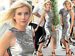 EXCLUSIVE: Actress Emma Roberts, wearing a silver and black flapper dress with strappy high heels, returns to her hotel in New York City on July 12, 2016.  Pictured: Emma Roberts Ref: SPL1317551  120716   EXCLUSIVE Picture by: Christopher Peterson/Splash News  Splash News and Pictures Los Angeles: 310-821-2666 New York: 212-619-2666 London: 870-934-2666 photodesk@splashnews.com