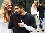 Gigi Hadid and Zayn Malik all smiles as they hold hands while out and about in NYC.\n\nPictured: Gigi Hadid and Zayn Malik\nRef: SPL1318440  130716  \nPicture by: JENY / Splash News\n\nSplash News and Pictures\nLos Angeles: 310-821-2666\nNew York: 212-619-2666\nLondon: 870-934-2666\nphotodesk@splashnews.com\n