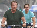 EXCLUSIVE. Coleman-Rayner Los Angeles, CA, USA.  July 13, 2016.  Arnold Schwarzenegger is spotted working out with his son, Joseph Baena, at Gold's gym in Venice and later going for a bike ride. CREDIT LINE MUST READ: Coleman-Rayner. Tel US (001) 310-474-4343- office Tel US (001) 323-545-7584 - Mobile www.coleman-rayner.com CREDIT LINE MUST READ: Coleman-Rayner. Tel US (001) 310-474-4343- office Tel US (001) 323-545-7584 - Mobile www.coleman-rayner.com