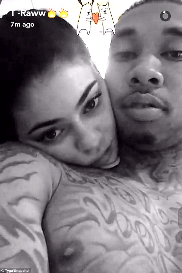 True love: Tyga shared a black and white photo to Snapchat on Tuesday of Kylie Jenner cuddling him
