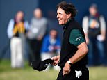 US golfer Phil Mickelson reacts after missing a putt on the 18th hole during his first round 63 on the opening day of the 2016 British Open Golf Championship at Royal Troon in Scotland on July 14, 2016. Former champion Phil Mickelson went clear at the top of the leaderboard at the British Open on Thursday after a stunning eight-under-par first round of 63 at Royal Troon.  / AFP PHOTO / ANDY BUCHANAN / RESTRICTED TO EDITORIAL USEANDY BUCHANAN/AFP/Getty Images