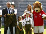 Football Soccer - Bayern Munich- Allianz Arena, Munich, Germany - 11/7/16 - Bayern Munich's new coach Carlo Ancelotti holds a pair of lederhosen next to a group of musicians in traditional Bavarian outfits at the stadium.     REUTERS/Michaela Rehle   TPX IMAGES OF THE DAY