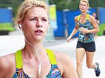 154930, EXCLUSIVE: A toned and fit Claire Danes seen listening to music on her iPhone while jogging on the Hudson River Parkway in NYC. Claire was also seen doing push-ups in between breaks. New York, New York, Thursday July 14, 2016. Photograph: © PacificCoastNews. Los Angeles Office (PCN): +1 310.822.0419 UK Office (Photoshot): +44 (0) 20 7421 6000 sales@pacificcoastnews.com FEE MUST BE AGREED PRIOR TO USAGE