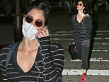 EXCLUSIVE: Sarah Silverman touches down at JFK airport in New York wearing a mask following recent brush with death after contracting epiglottitis.\n\nPictured: Sarah Silverman\nRef: SPL1317531  130716   EXCLUSIVE\nPicture by: Ryan Turgeon/Splash News\n\nSplash News and Pictures\nLos Angeles: 310-821-2666\nNew York: 212-619-2666\nLondon: 870-934-2666\nphotodesk@splashnews.com\n