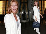 EXCLUSIVE: Karlie Kloss wears an emerald studded choker to complement her all-white wardrobe while visiting Facebook office in New York City.\n\nPictured: Karlie Kloss\nRef: SPL1319219  140716   EXCLUSIVE\nPicture by: Splash News\n\nSplash News and Pictures\nLos Angeles: 310-821-2666\nNew York: 212-619-2666\nLondon: 870-934-2666\nphotodesk@splashnews.com\n