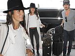 July 14, 2016: Nikki Reed and Ian Somerhalder catch a departing flight to Atlanta from LAX Aiport in Los Angeles, California.\nMandatory Credit: INFphoto.com Ref: inf-00