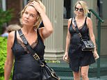 New York, NY - Pregnant Australian model and media personality Lara Worthington looks flawless as she strolls through the streets of Tribeca wearing a black dress showing some cleavage and matching suede booties.\n  \nAKM-GSI       July 14, 2016\nTo License These Photos, Please Contact :\nMaria Buda\n(917) 242-1505\nmbuda@akmgsi.com\nsales@akmgsi.com\nor\nMark Satter\n(317) 691-9592\nmsatter@akmgsi.com\nsales@akmgsi.com\nwww.akmgsi.com
