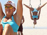 July 15, 2016: Lindsey Vonn keeps toned and strong as she lunges, balances, and rope pull-ups her way into health on Venice Beach.  Vonn showed off her athletically toned figure in a blue sports bra and blue shorts.\nMandatory Credit: Mariotto/Chiva/INFphoto.com Ref.: infusla-244/276