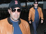 Los Angeles, CA - Ben Affleck is spotted departing LAX. The actor keeps it cool in a tan leather varsity jacket, denim, and navy blue tee paired with sunglasses and a cap. He rushes through the terminal to make his flight.\nAKM-GSI       July 16, 2016\nTo License These Photos, Please Contact :\nMaria Buda\n(917) 242-1505\nmbuda@akmgsi.com\nsales@akmgsi.com\nor \nMark Satter\n(317) 691-9592\nmsatter@akmgsi.com\nsales@akmgsi.com\nwww.akmgsi.com
