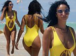 Draya Michele, 31, shows off her post baby body at the beach in Miami Beach, FL. Draya wore a white one piece swimsuit with a plunging top that showed off her curves.\n\nPictured: Draya Michele\nRef: SPL1320518  170716  \nPicture by: Pichichi / Splash News\n\nSplash News and Pictures\nLos Angeles: 310-821-2666\nNew York: 212-619-2666\nLondon: 870-934-2666\nphotodesk@splashnews.com\n
