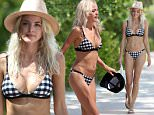 155024, EXCLUSIVE: Model and blogger Kaitlynn Carter wears a tiny bikini and her giant engagement ring to the beach in Miami. Kaitlynn, who is engaged to Brody Jenner, stunned in a black and white bikini as she walked on the beach and back to her hotel. 27 year old Kaitlynn run's fashion blog  'The Western Wild' and is in Miami to attend Miami Swim Week, and join Brody, who is DJ'ing this evening. Miami, Florida - Saturday July 16, 2016. Photograph: Brett Kaffee/Thibault Monnier,© PacificCoastNews. Los Angeles Office (PCN): +1 310.822.0419 UK Office (Photoshot): +44 (0) 20 7421 6000 sales@pacificcoastnews.com FEE MUST BE AGREED PRIOR TO USAGE