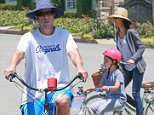 Picture Shows: Adam Sandler, Sunny Sandler  July 16, 2016\n \n Actor and comedian Adam Sandler bikes with his wife and kids in Brentwood, California. His daughters wore helmets, but him and his wife did not.\n \n Non Exclusive\n UK RIGHTS ONLY\n \n Pictures by : FameFlynet UK © 2016\n Tel : +44 (0)20 3551 5049\n Email : info@fameflynet.uk.com