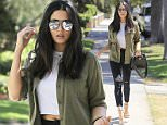 *EXCLUSIVE* Beverly Hills, CA - Jessica Gomes shows off her casual chic street style with mirrored sunglasses, grey crop top, army green coat, ripped black denim, and embellished silver heels. \nAKM-GSI          July 15, 2016\nTo License These Photos, Please Contact :\nMaria Buda\n(917) 242-1505\nmbuda@akmgsi.com\nsales@akmgsi.com\nor \nMark Satter\n(317) 691-9592\nmsatter@akmgsi.com\nsales@akmgsi.com