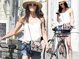 New York, NY - 07/17/16   Sean Avery and Hilary Rhoda Riding Bikes in Soho while shopping and having a hard time locking up their bikes\n-PICTURED: Hilary Rhoda\n-PHOTO by: Adam Nemser/startraksphoto.com\n-NEM_48288.JPG\nEditorial - Rights Managed Image - Please contact www.startraksphoto.com for licensing fee\nStartraks Photo\nNew York, NY\nFor licensing please call 212-414-9464 or email sales@startraksphoto.com\nImage may not be published in any way that is or might be deemed defamatory, libelous, pornographic, or obscene. Please consult our sales department for any clarification or question you may have.\nStartraks Photo reserves the right to pursue unauthorized users of this image. If you violate our intellectual property you may be liable for actual damages, loss of income, and profits you derive from the use of this image, and where appropriate, the cost of collection and/or statutory damages.