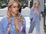 eURN: AD*213210868  Headline: Rita Ora returns home after a photoshoot with colorful pigtails Caption: New York, NY - Rita Ora is seen returning to her apartment after a photoshoot. The 25-year-old singer is wearing a blue and white striped jumpsuit paired with white sneakers. Rita has her hair worn in pigtails with colorful ribbon braided into her hair.  AKM-GSI      July 17, 2016 To License These Photos, Please Contact : Maria Buda (917) 242-1505 mbuda@akmgsi.com sales@akmgsi.com Mark Satter (317) 691-9592 msatter@akmgsi.com sales@akmgsi.com www.akmgsi.com Photographer: TYJA  Loaded on 17/07/2016 at 23:49 Copyright:  Provider: T Jackson/AKM-GSI  Properties: RGB JPEG Image (20678K 1262K 16.4:1) 2169w x 3254h at 300 x 300 dpi  Routing: DM News : GeneralFeed (Miscellaneous) DM Showbiz : SHOWBIZ (Miscellaneous) DM Online : Online Previews (Miscellaneous), CMS Out (Miscellaneous)  Parking: