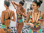 EXCLUSIVE TO INF.\nJuly 16, 2016: Actress and singer Victoria Justice wears a floral one piece swimsuit as she acts as photographer during an impromptu photoshoot with a friend by the pool in Miami, Florida\nMandatory Credit: INFphoto.com Ref: infusmi-20/21
