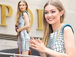 New York, NY - Gigi Hadid looks amazing in a metallic looking dress while doing a photo shoot on sightseeing bus in downtown New York.\nAKM-GSI          July 18, 2016\nTo License These Photos, Please Contact:\nMaria Buda\n(917) 242-1505\nmbuda@akmgsi.com\nsales@akmgsi.com\nor \nMark Satter\n(317) 691-9592\nmsatter@akmgsi.com\nsales@akmgsi.com\nwww.akmgsi.com