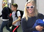Los Angeles, CA - Reese Witherspoon and her son Deacon jet out of LAX together. Reese seems to be in a hurry as she looks a little disheveled with wet hair.\n  \nAKM-GSI       July 17, 2016\nTo License These Photos, Please Contact :\nMaria Buda\n(917) 242-1505\nmbuda@akmgsi.com\nsales@akmgsi.com\nMark Satter\n(317) 691-9592\nmsatter@akmgsi.com\nsales@akmgsi.com\nwww.akmgsi.com