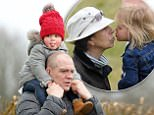 Mike Tindall carries daughter Mia Tindall on his shoulders as they attend the Gatcombe