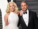 BEVERLY HILLS, CA - FEBRUARY 28:  Lady Gaga and Taylor Kinney attend the 2016 Vanity Fair Oscar Party Hosted By Graydon Carter at Wallis Annenberg Center for the Performing Arts on February 28, 2016 in Beverly Hills, California.  (Photo by Karwai Tang/WireImage)