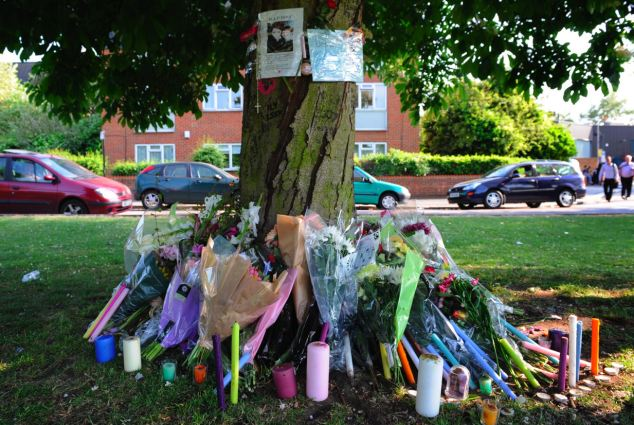 Untimely death: Flowers and candles were left in tribute to the schoolgirl who started foaming at the mouth