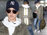 """New York, NY - Gigi Hadid gears up to fly the skies as she arrives at JFK for a departing flight. The 21-year-old model is wearing two toned skinny jeans and a white hoodie paired with a custom olive green """"Gigi"""" jacket and Adidas sneakers. \nAKM-GSI       July 20, 2016\nTo License These Photos, Please Contact :\nMaria Buda\n(917) 242-1505\nmbuda@akmgsi.com\nsales@akmgsi.com\nMark Satter\n(317) 691-9592\nmsatter@akmgsi.com\nsales@akmgsi.com\nwww.akmgsi.com"""