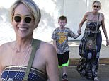*EXCLUSIVE* Beverly Hills, CA - Proud mama and esteemed actress, Sharon Stone takes a casual trip to Beverly Hills with her son, Quinn Kelly Stone. The two are accompanied by an unidentified female guest, who gives the mother and son duo some space as they make their way to their vehicle. Stone is in a great mood as she flashes a peace sign and a smile to the camera man.\nAKM-GSI      July 20, 2016\nTo License These Photos, Please Contact :\nMaria Buda\n(917) 242-1505\nmbuda@akmgsi.com\nsales@akmgsi.com\nor\nMark Satter\n(317) 691-9592\nmsatter@akmgsi.com\nsales@akmgsi.com\nwww.akmgsi.com